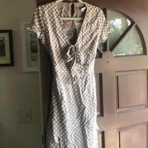 Tan and white polka dot high slit dress